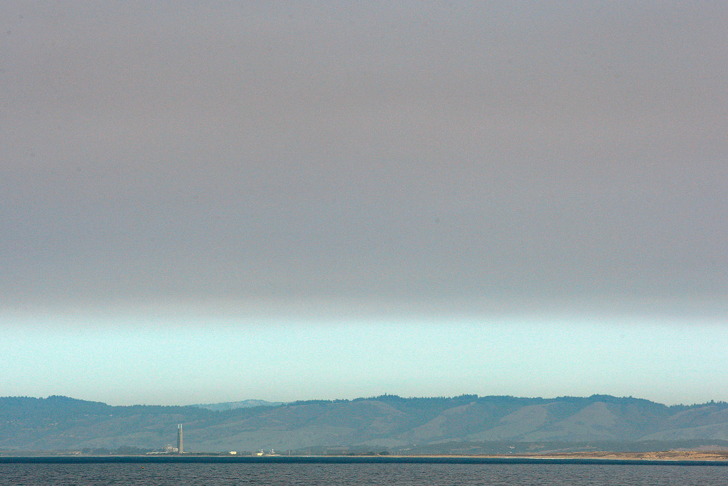 . Looking north from Pacific Grove towards Moss Landing as drift smoke from fires burning in southern California hangs over the Monterey County coastline on Monday, Dec. 11, 2017.  (Vern Fisher - Monterey Herald)