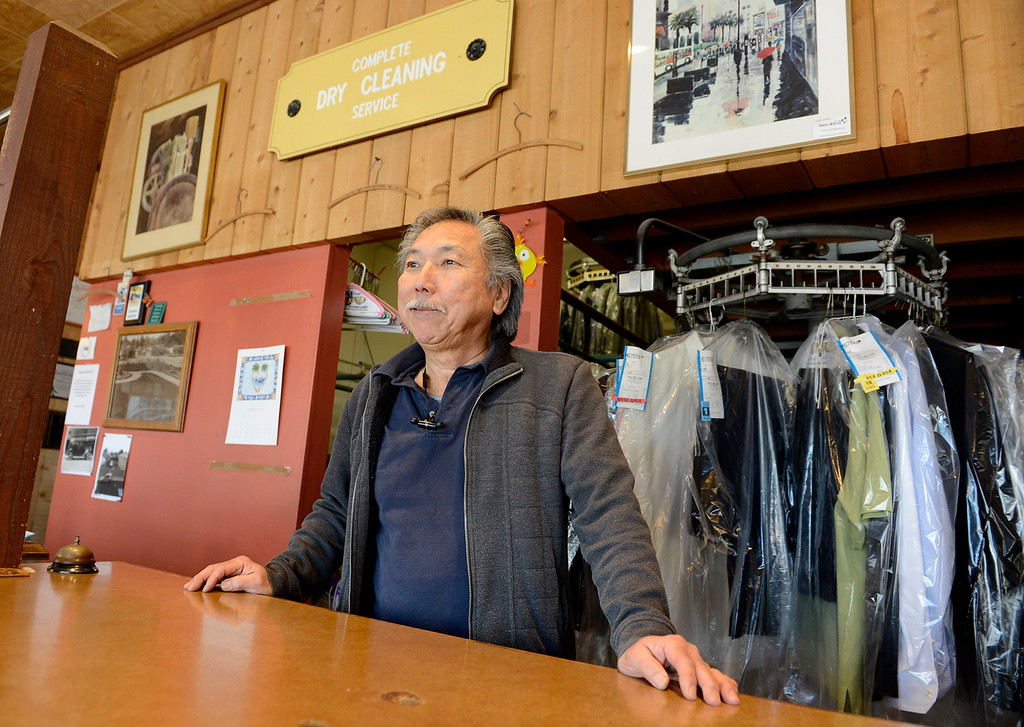 . Randy Uchida operator of the Pacific Grove Cleaners on Grand Street in Pacific Grove on Tuesday, Feb. 20, 2018.  (Vern Fisher - Monterey Herald)