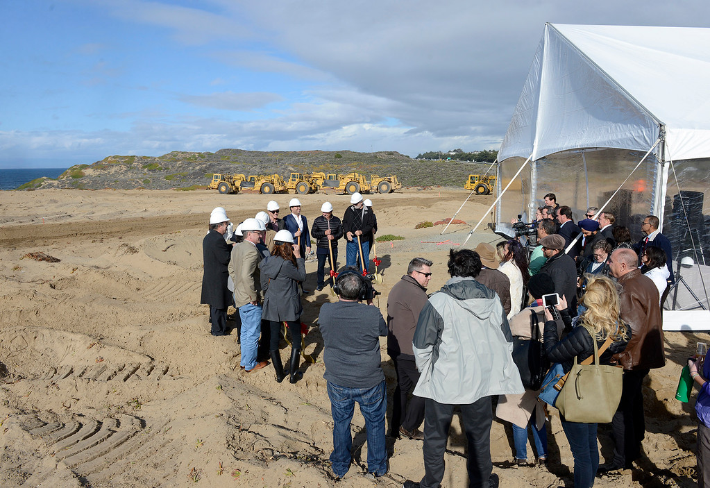 . Local dignitaries join resort developer Ed Ghandour attends the groundbreaking ceremony of the Monterey Bay Shores Resort, a luxury eco-resort being built in Sand City on Thursday, Feb. 22, 2018.  The mixed-use project consists of 184 hotel rooms, 92 hotel condominium units and 92 residential condominiums.  (Vern Fisher - Monterey Herald)