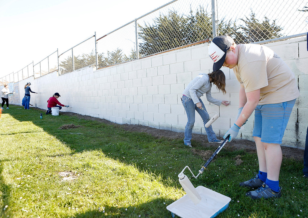 . Noah Stackpole, right, and Normandy Flicek, both 11,  paint a retaining wall with others as Friends of Marina Parks work at Gloria Jean Tate Park In Marina on Saturday September 17, 2018. (David Royal/Herald Correspondent)