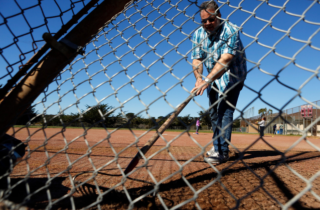 . Mike Dinkel clears weeds and rocks from the softball field as Friends of Marina Parks work at Gloria Jean Tate Park In Marina on Saturday September 17, 2018. (David Royal/Herald Correspondent)