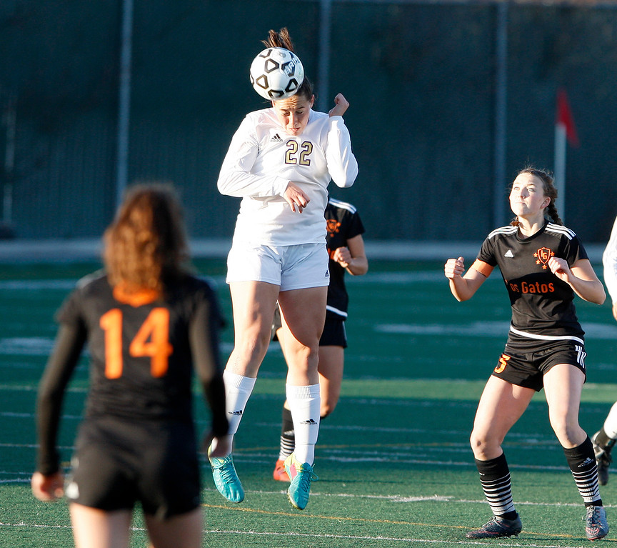 . Salinas High\'s Alexa Aguirre (22) heads the ball during their CCS DIV soccer playoff match against Los Gatos High School on Wednesday, Feb. 21, 2018.   (Vern Fisher - Monterey Herald)
