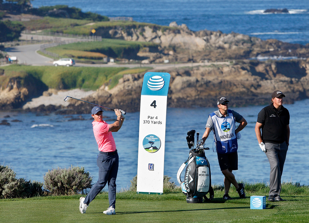 . Rory McIlroy tees off on the fourth hole at Spyglass Hill Golf Course during the first round of the AT&T Pebble Beach Pro-Am on Thursday, Feb. 8, 2018.  (Vern Fisher - Monterey Herald)