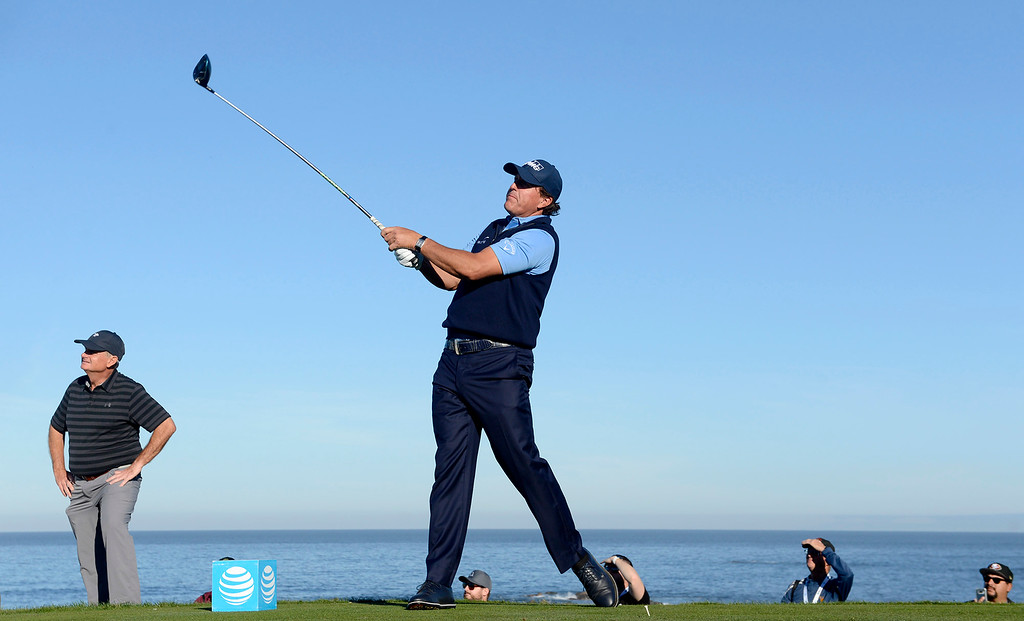 . Phil Mickelson tees off on the 12th hole at Monterey Peninsula Country Club Shore Course during the second round of the AT&T Pebble Beach Pro-Am on Friday, Feb. 9, 2018.  (Vern Fisher - Monterey Herald)