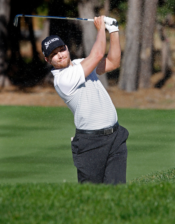 . Chris Stroud hits his second shot on the sixth hole at Spyglass Hill Golf Course during the first round of the AT&T Pebble Beach Pro-Am on Thursday, Feb. 8, 2018.  (Vern Fisher - Monterey Herald)