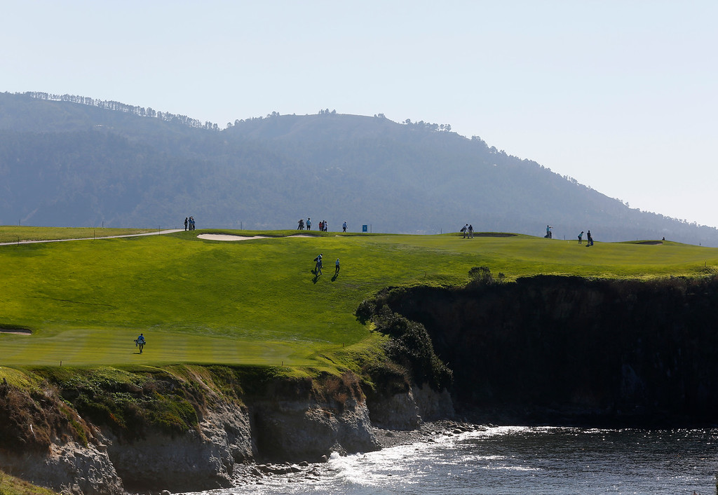. Players pass through the sixth fairway during practice rounds before the AT&T Pebble Beach Pro-Am Pebble Beach Golf Links on Monday February 5, 2018. Photo by David Royal)