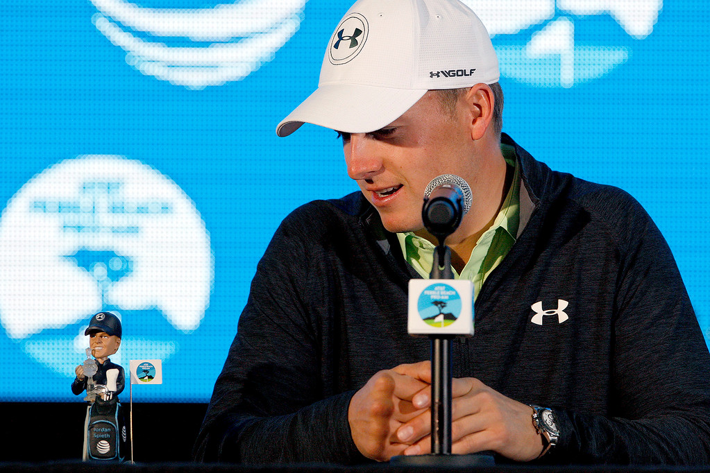 ". Defending AT&T Pebble Beach champion Jordan Spieth admires his latest ""bobble head\"" at the Pebble Beach Golf Links in Pebble Beach on Wednesday, Feb. 7, 2018.   (Vern Fisher - Monterey Herald)"