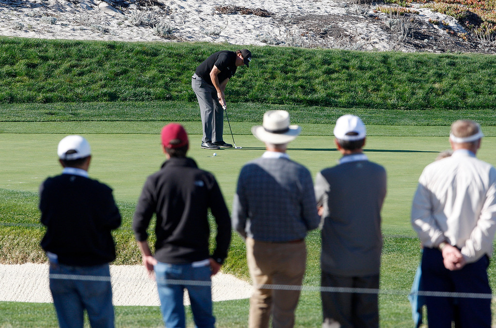 . Phil Mickelson putts on the fifth hole at Spyglass Hill Golf Course during the first round of the AT&T Pebble Beach Pro-Am on Thursday, Feb. 8, 2018.  (Vern Fisher - Monterey Herald)