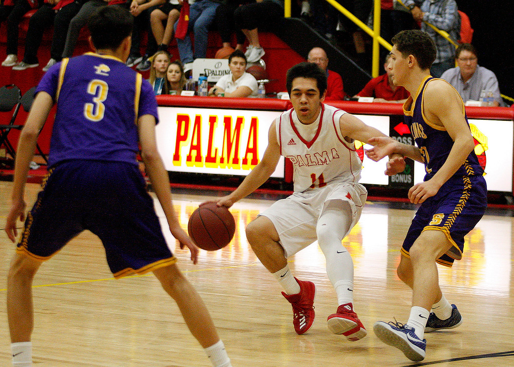 . Palma\'s Joey Burlison (11) battles David Orozco (3) and Jarret Edria (22) during their game in Salinas on Friday, Feb. 2, 2018.  (Vern Fisher - Monterey Herald)