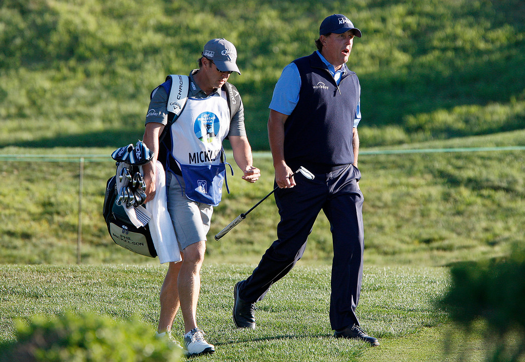 . Phil Mickelson walks with his new caddy Tim Mickelson, his brother, on the 11th hole at Monterey Peninsula Country Club Shore Course during the second round of the AT&T Pebble Beach Pro-Am on Friday, Feb. 9, 2018.  (Vern Fisher - Monterey Herald)