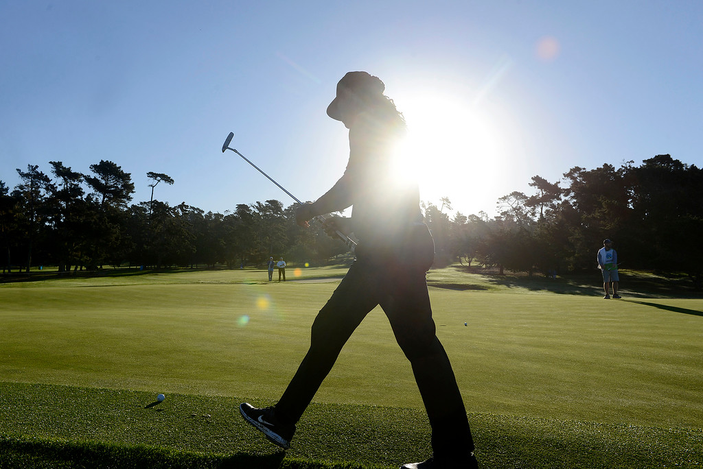 . Larry Fitzgerald of the Arizona Cardinals walks in the morning sunshine while playing on the first hole at Spyglass Hill Golf Course during the first round of the AT&T Pebble Beach Pro-Am on Thursday, Feb. 8, 2018.  (Vern Fisher - Monterey Herald)