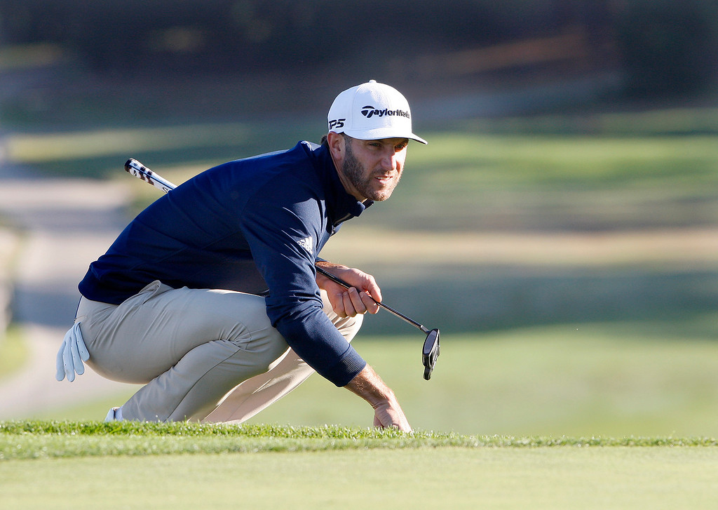 . Dustin Johnson lines up a putt on the second hole at Spyglass Hill Golf Course during the first round of the AT&T Pebble Beach Pro-Am on Thursday, Feb. 8, 2018.  (Vern Fisher - Monterey Herald)
