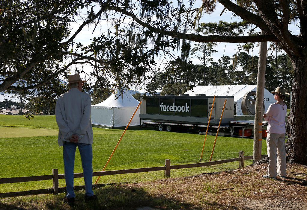 . A couple look out over the Peter Hay Golf Course where a Facebook trailer has been set up during preparations for the AT&T Pebble Beach Pro-Am on Sunday February 4, 2018. Photo by David Royal)