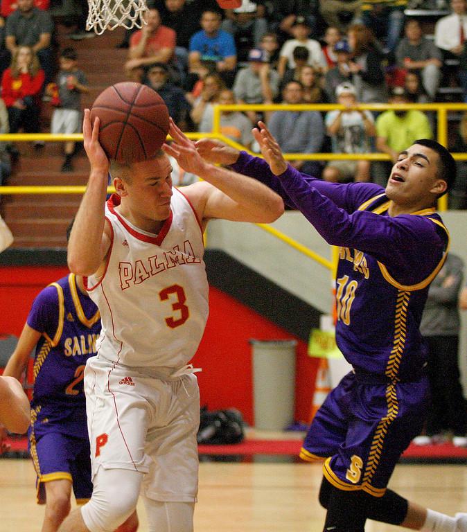 . Palma\'s Garrett Maker (3) battles Salinas High\'s AJ Saldana (10) during their game in Salinas on Friday, Feb. 2, 2018.  (Vern Fisher - Monterey Herald)