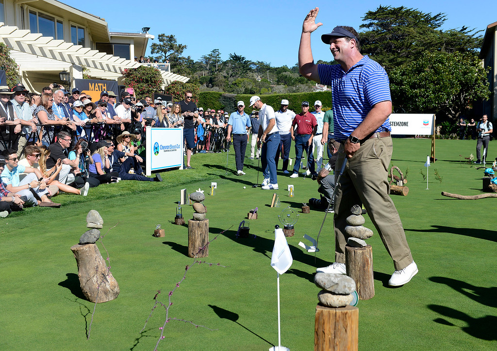 . Former San Francisco 49er Harris Barton acknowledges the crowd during the Chevron Shoot-Out at the Pebble Beach Golf Links practice green on Tuesday, Feb. 6, 2018.  The Chevron Shoot-Out is a two-person teams that faced off in a five-hole putting challenge for charity. Teams were made by pairing past tournament champions with champions from other sports.  (Vern Fisher - Monterey Herald)