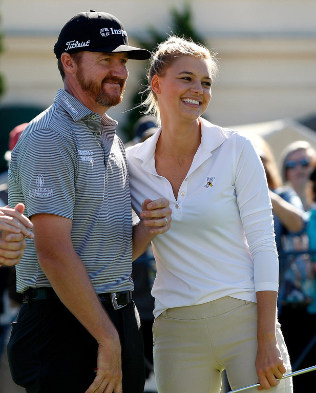 . PGA pro Jimmy Walker with actress Kelly Rohrbach in the Chevron Shoot-Out at the Pebble Beach Golf Links practice green on Tuesday, Feb. 6, 2018.  The Chevron Shoot-Out is a two-person teams that faced off in a five-hole putting challenge for charity. Teams were made by pairing past tournament champions with champions from other sports.  (Vern Fisher - Monterey Herald)