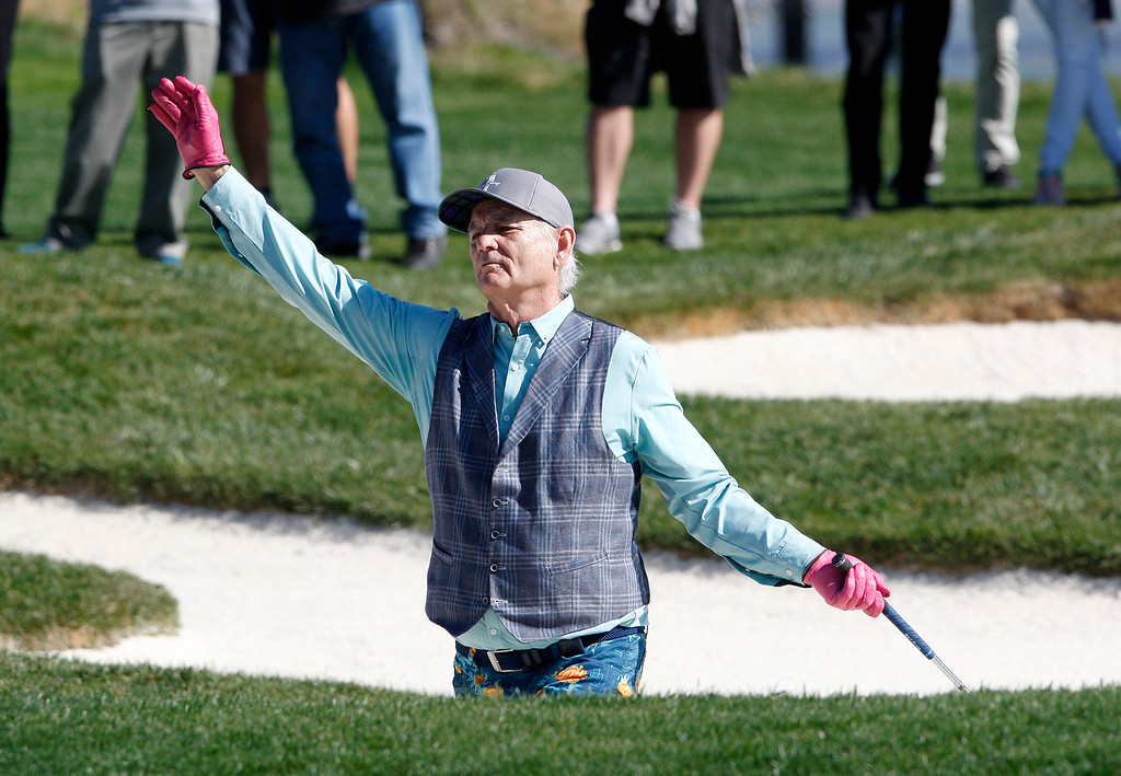 . Bill Murray waves to the crowd from the bunker on the 17th hole during the 3M Celebrity Shoot-Out at the Pebble Beach Golf Links in Pebble Beach on Wednesday, Feb. 7, 2018.   (Vern Fisher - Monterey Herald)
