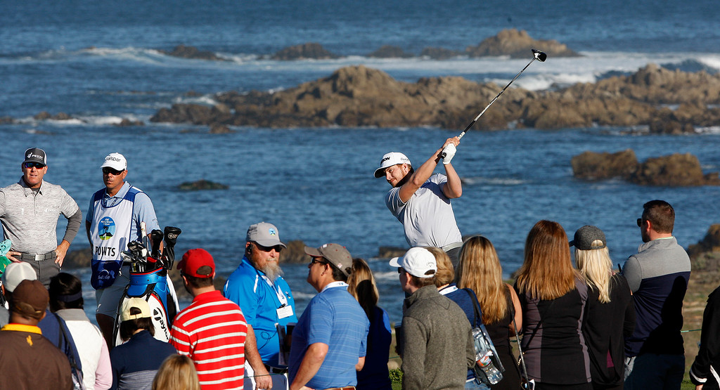 . Chris Stroud tees off on the 13th hole at Monterey Peninsula Country Club Shore Course during the second round of the AT&T Pebble Beach Pro-Am on Friday, Feb. 9, 2018.  (Vern Fisher - Monterey Herald)