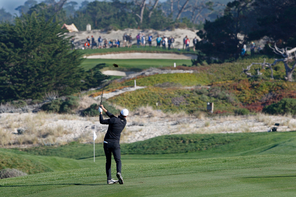 . Jordan Spieth hits his second shot on the fourth hole Spyglass Hill Golf Course during the first round of the AT&T Pebble Beach Pro-Am on Thursday, Feb. 8, 2018.  (Vern Fisher - Monterey Herald)