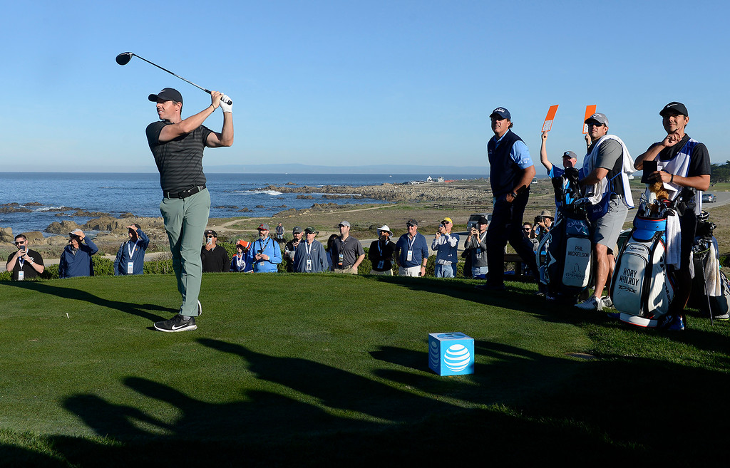 . Rory McIlroy tees off on the 13th hole at Monterey Peninsula Country Club Shore Course during the second round of the AT&T Pebble Beach Pro-Am on Friday, Feb. 9, 2018.  (Vern Fisher - Monterey Herald)
