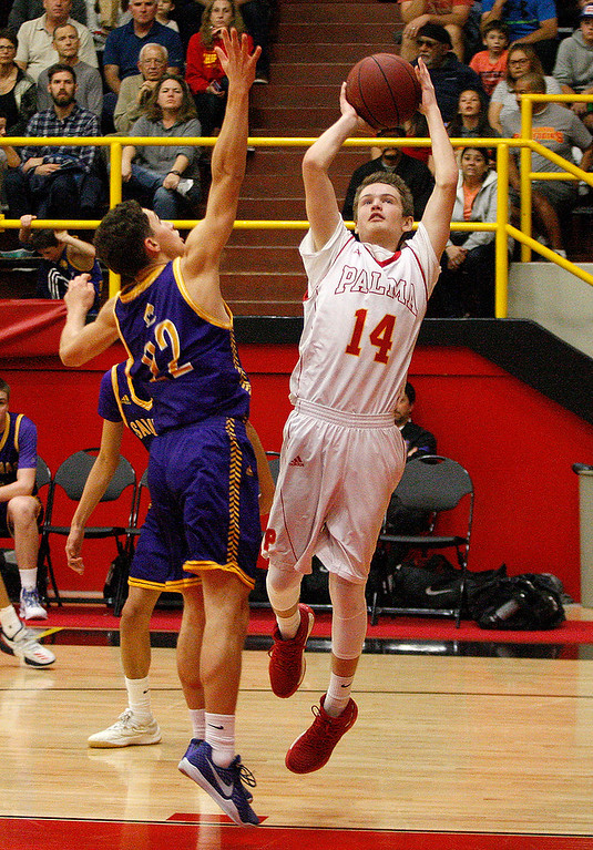 . Salinas High\'s Jarret Edria (22) tries to block the shot of Palma\'s Evan Pia (14) during their game in Salinas on Friday, Feb. 2, 2018.  (Vern Fisher - Monterey Herald)