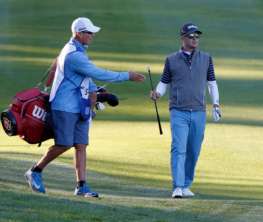 . Kevin Streelman hands a club to his caddy while playing the first hole at Spyglass Hill Golf Course during the first round of the AT&T Pebble Beach Pro-Am on Thursday, Feb. 8, 2018.  (Vern Fisher - Monterey Herald)