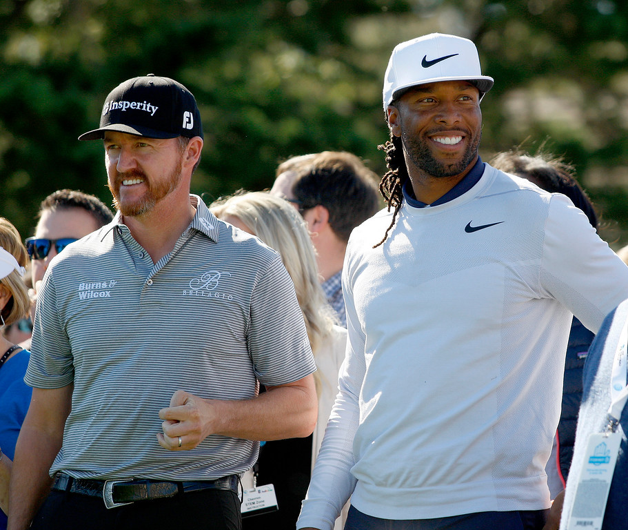 . PGA pro Jimmy Walker with Larry Fitzgerald in the Chevron Shoot-Out at the Pebble Beach Golf Links practice green on Tuesday, Feb. 6, 2018.  The Chevron Shoot-Out is a two-person teams that faced off in a five-hole putting challenge for charity. Teams were made by pairing past tournament champions with champions from other sports.  (Vern Fisher - Monterey Herald)