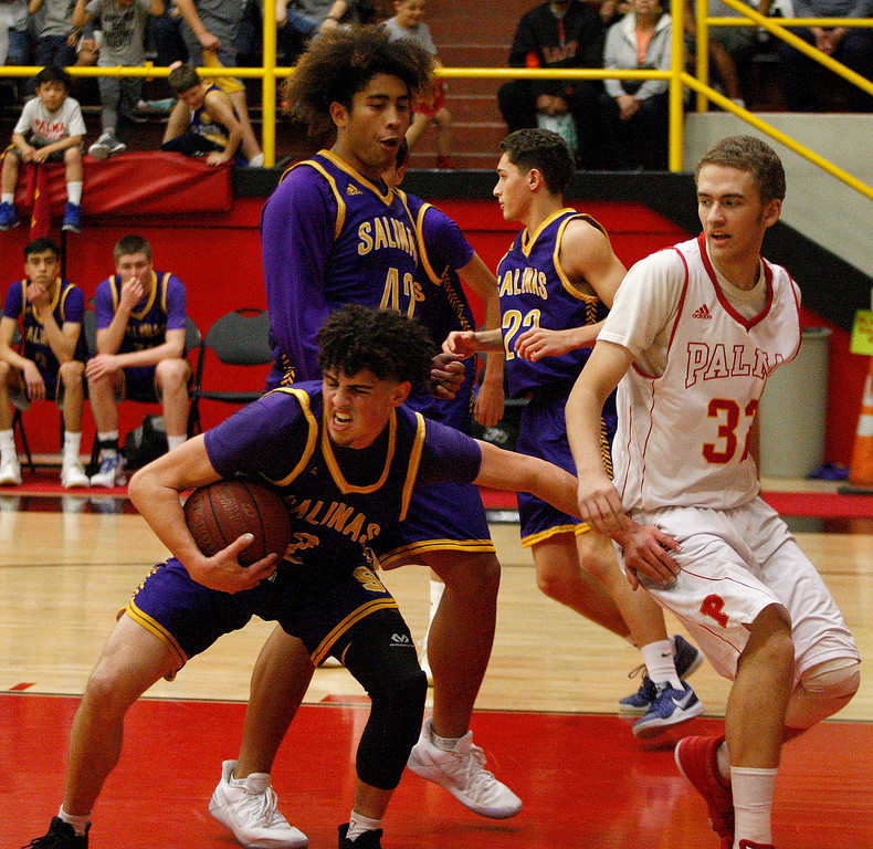 . Salinas High\'s Caden Batista (2) gets a rebound away from Palma\'s Colin Neff (32) during their game in Salinas on Friday, Feb. 2, 2018.  (Vern Fisher - Monterey Herald)