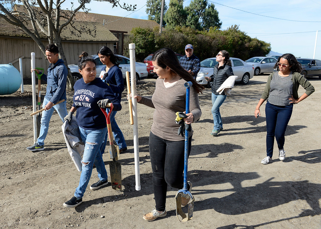 . Gonzales High School students head out to a agriculture field at Pisoni Farms in Gonzales as part of their school project that was placing sensors to monitor water levels in the soil on Friday, Feb. 2, 2018.  (Vern Fisher - Monterey Herald)