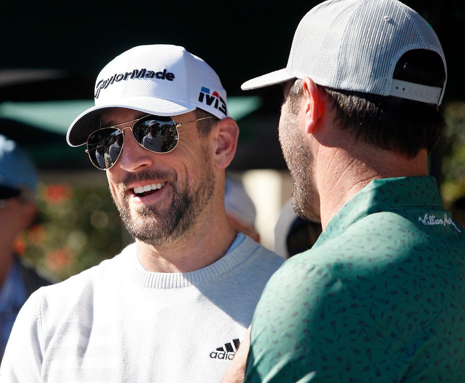 . Aaron Rodgers from the Green Bay Packers talks with Justin Verlander from the Houston Astros during the Chevron Shoot-Out at the Pebble Beach Golf Links practice green on Tuesday, Feb. 6, 2018.  The Chevron Shoot-Out is a two-person teams that faced off in a five-hole putting challenge for charity. Teams were made by pairing past tournament champions with champions from other sports.  (Vern Fisher - Monterey Herald)