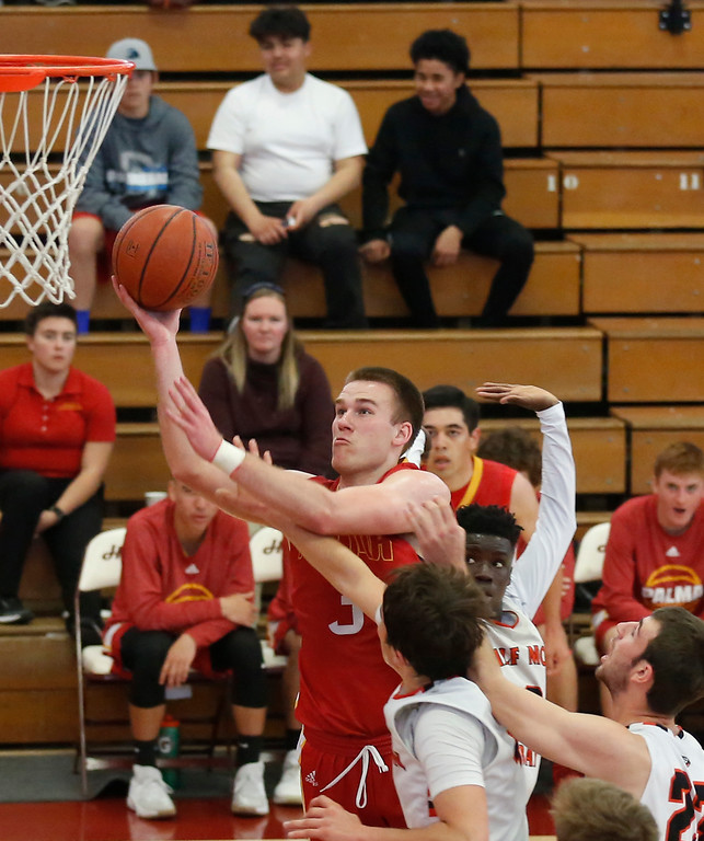 . Palma\'s Garrett Maker shoots against Half Moon Bay during CCS playoff basketball at Hartnell College in Salinas, Calif. on Saturday February 24, 2018. (David Royal/Herald Correspondent)