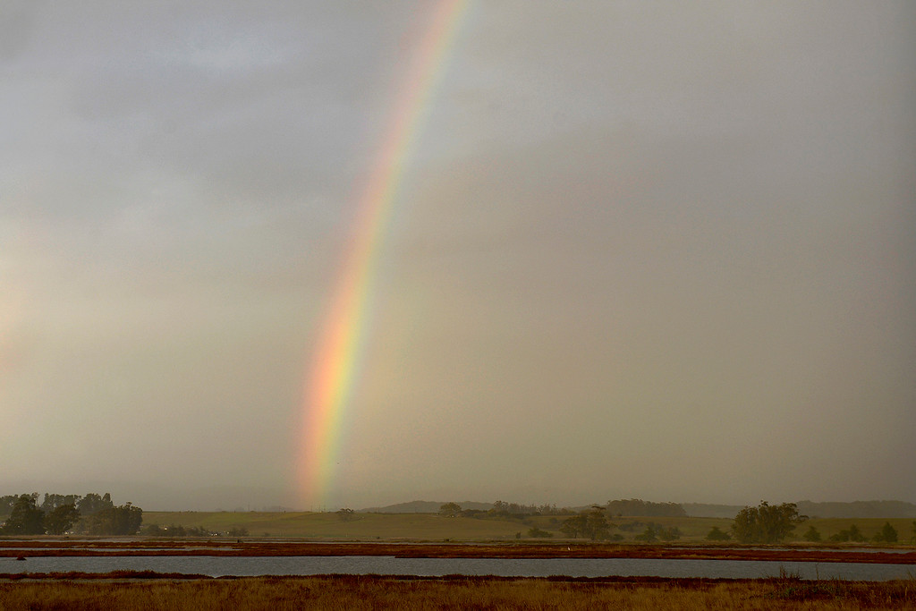 . A rainbow over the Elkhorn Slough in Moss Landing on Thursday, March 1, 2018.  (Vern Fisher - Monterey Herald)