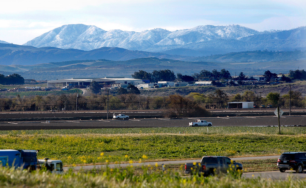 . Looking towards the Los Padres National Forest from Castroville as fresh snow covers the higher peaks in Monterey County on Tuesday, Feb. 27, 2018.  (Vern Fisher - Monterey Herald)