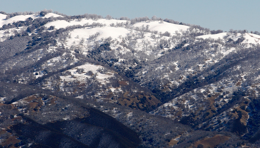 . Fresh snow on the higher peaks of Carmel Valley on Tuesday, Feb. 27, 2018.  (Vern Fisher - Monterey Herald)