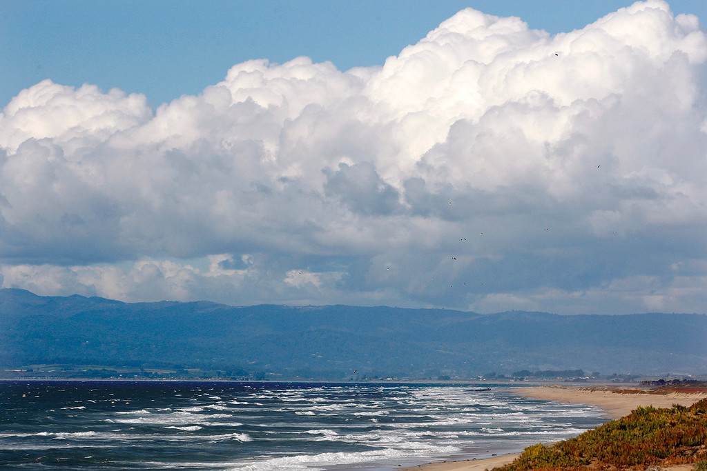 . Looking north from Marina State Beach as storm clouds build up over Santa Cruz County on Monday, Feb. 26, 2018.  (Vern Fisher - Monterey Herald)