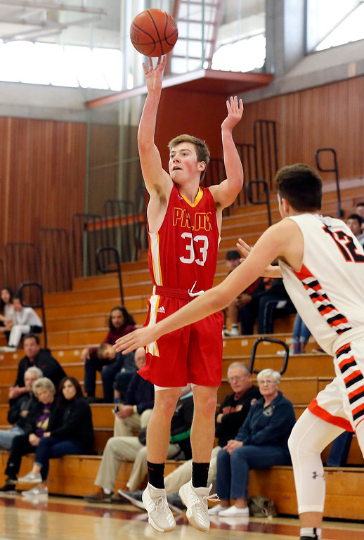 . Palma\'s Peter Powers shoots against Half Moon Bay\'s   during CCS playoff basketball at Hartnell College in Salinas, Calif. on Saturday February 24, 2018. (David Royal/Herald Correspondent)