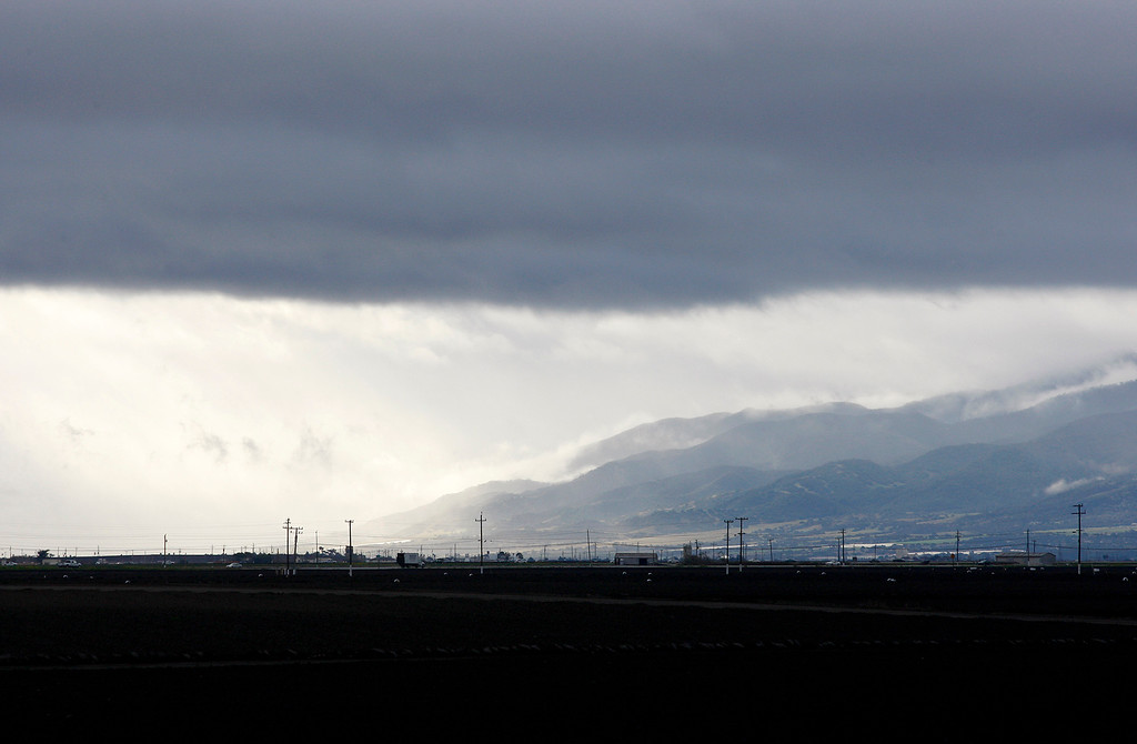 . Looking south down the Salinas Valley as storm clouds rise above on Thursday, March 1, 2018.  (Vern Fisher - Monterey Herald)
