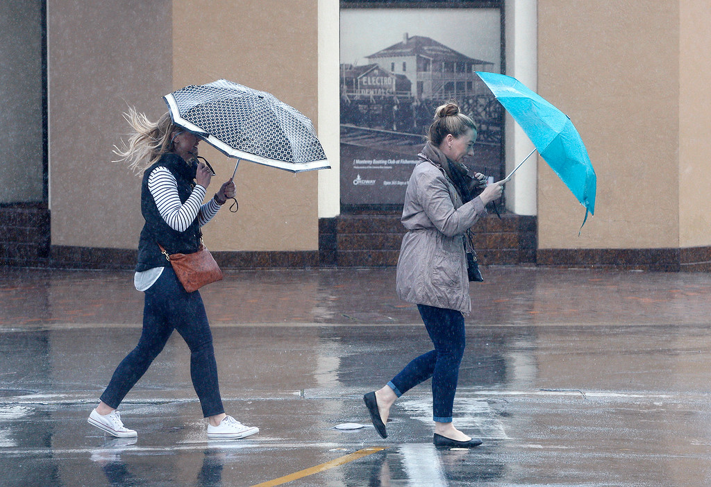 . Two women get blasted by rain in Monterey on Thursday, March 1, 2018.  (Vern Fisher - Monterey Herald)
