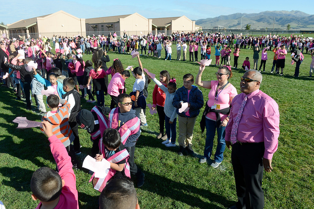 . Dr. Roberto Nunez, principal at Monte Bella Elementary School lines up with students that were wearing pink and spelling the word RESPETO on the ground so it can be captured by a flying drone on Wednesday, Feb. 14, 2018.   The event and photo is  part of the school\'s ongoing anti-bullying activities.  (Vern Fisher - Monterey Herald)