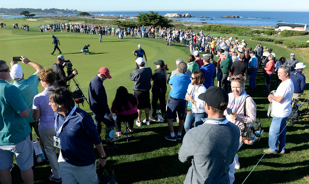 . Phil Mickelson with a large gallery on the 15th hole at Monterey Peninsula Country Club Shore Course during the second round of the AT&T Pebble Beach Pro-Am on Friday, Feb. 9, 2018.  (Vern Fisher - Monterey Herald)