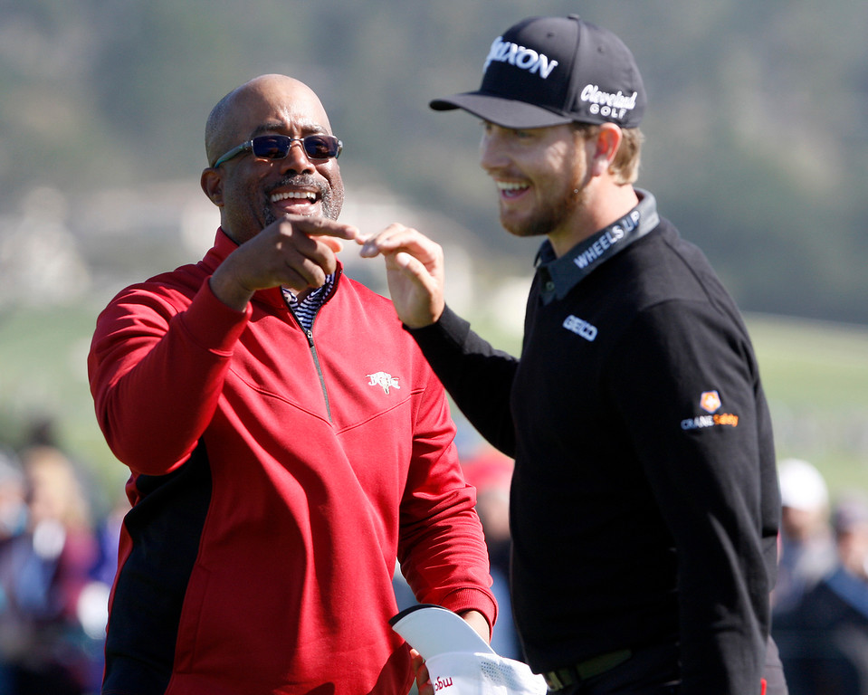 . Darius Rucker with his partner Chris Stroud on the 6th hole at the Pebble Beach Golf Links during the third round of the AT&T Pebble Beach Pro-Am on Saturday, Feb. 10, 2018.  (Vern Fisher - Monterey Herald)