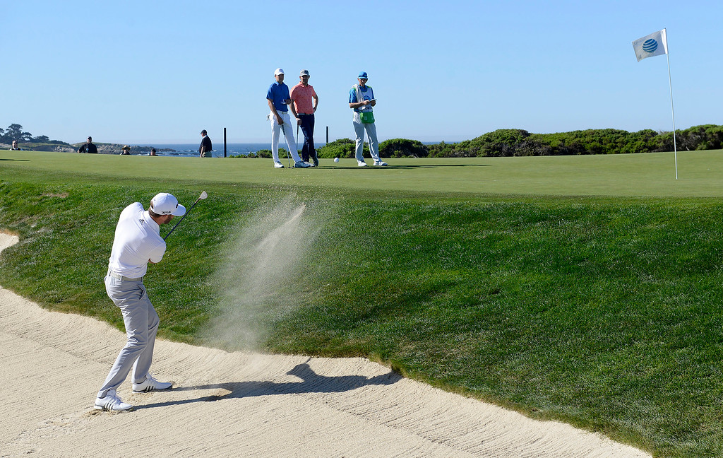 . Dustin Johnson hits from a bunker on the 13th hole at Monterey Peninsula Country Club Shore Course during the second round of the AT&T Pebble Beach Pro-Am on Friday, Feb. 9, 2018.  (Vern Fisher - Monterey Herald)