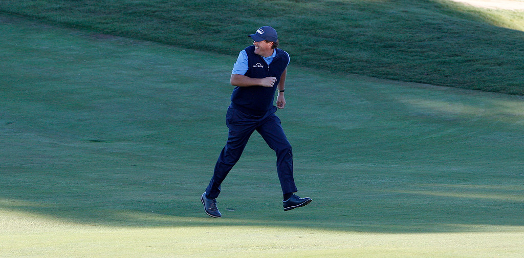 . Phil Mickelson runs across the 10th hole green at Monterey Peninsula Country Club Shore Course during the second round of the AT&T Pebble Beach Pro-Am on Friday, Feb. 9, 2018.  (Vern Fisher - Monterey Herald)