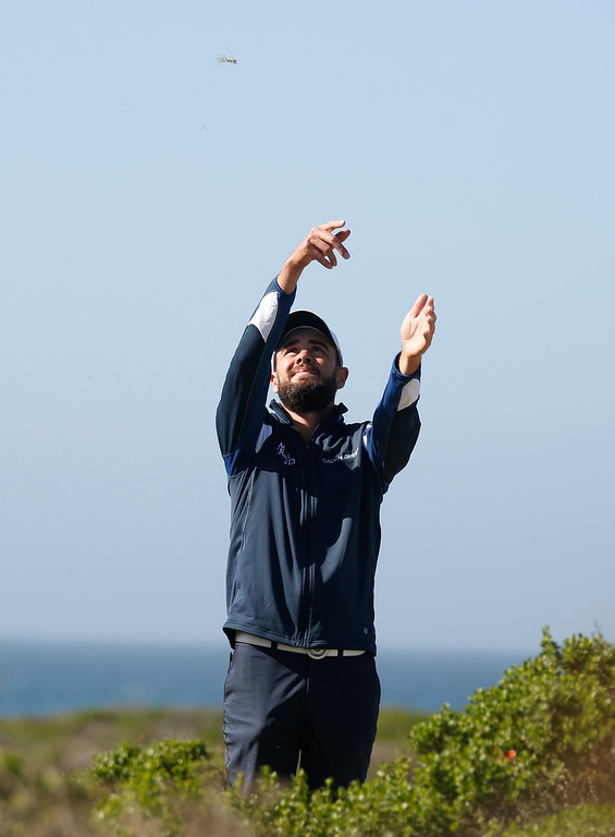 . Troy Merritt checks the wind direction on the 14th tee at Monterey Peninsula Country Club during the third round of the AT&T Pebble Beach Pro-Am in Pebble Beach, Calif. on Saturday February 10, 2018. Merritt birdied the hole. (David Royal/Herald Correspondent)