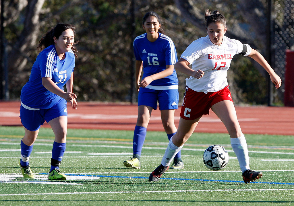 . King City High\'s Cinthia Zavala (31) and Esme Alvarez (16) try to get the ball from Carmel High\'s  Adriana Vargas (12) during their match in Carmel on Wednesday, 14, 2018.  (Vern Fisher - Monterey Herald)