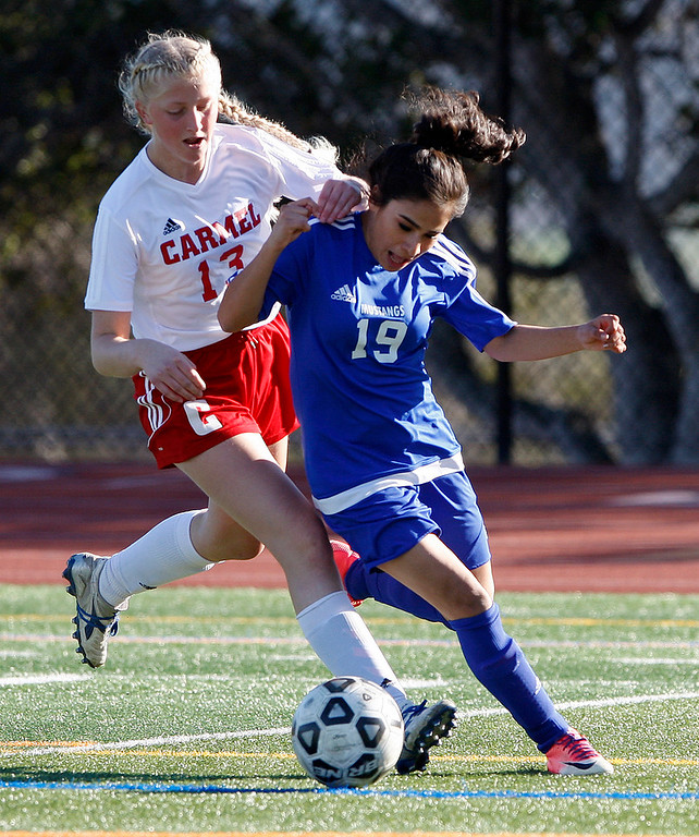 . Carmel High\'s Olivia Myers (13) battles King City High\'s Andrea Rodriguez (19) during their match in Carmel on Wednesday, 14, 2018.  (Vern Fisher - Monterey Herald)