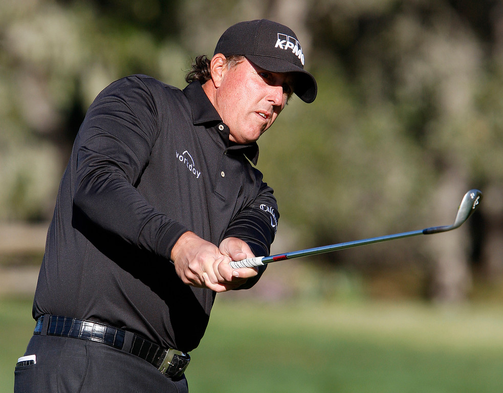 . Phil Mickelson chips on to the second hole green at the Pebble Beach Golf Links during the final round of the AT&T Pebble Beach Pro-Am on Sunday, Feb. 11, 2018.  (Vern Fisher - Monterey Herald)