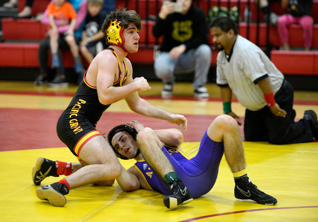 . Pacific Grove High\'s Sal Flores celebrates his pin against Soledad High\'s Max Valenzuela during the 140 pound consolation match in the MTAL wrestling meet in Pacific Grove on Thursday, Feb. 15, 2018.  (Vern Fisher - Monterey Herald)