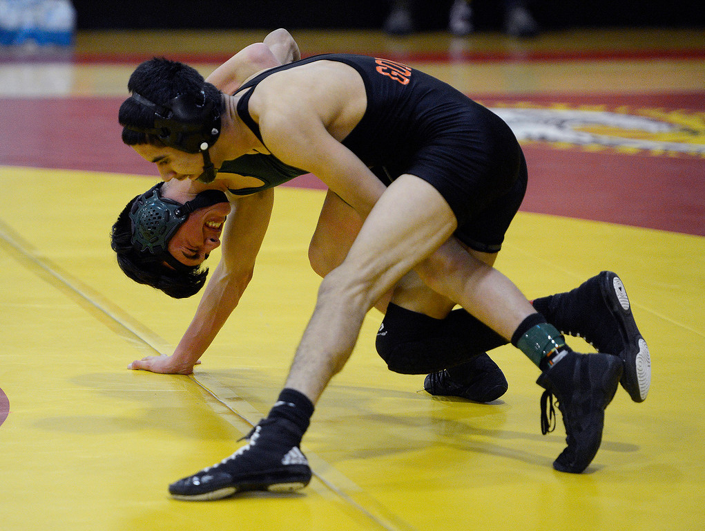 . Gonzales High\'s Miguel Mendoza (top) beats Jonathan Lopez from Greenfield High in the 115 pound match at the MTAL wrestling meet in Pacific Grove on Thursday, Feb. 15, 2018.  (Vern Fisher - Monterey Herald)