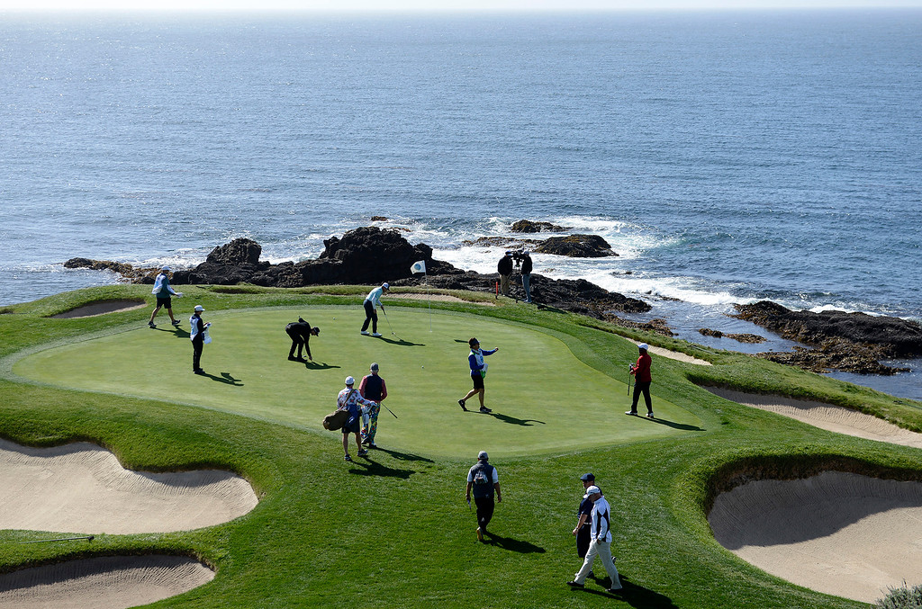 . Action on the 7th green at the Pebble Beach Golf Links during the third round of the AT&T Pebble Beach Pro-Am on Saturday, Feb. 10, 2018.  (Vern Fisher - Monterey Herald)